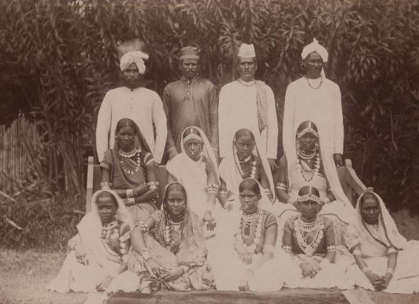 Indentured men and women posing in front of a canefield in Guyana